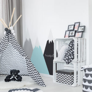 Modern child room with tent, crate storage and pattern pillows